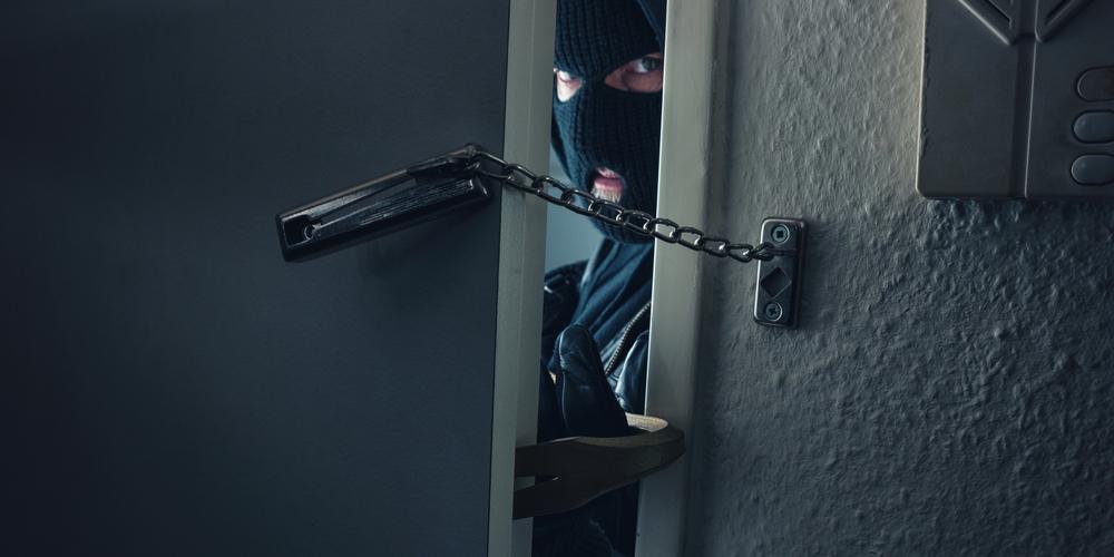 Thief Breaking Into Door
