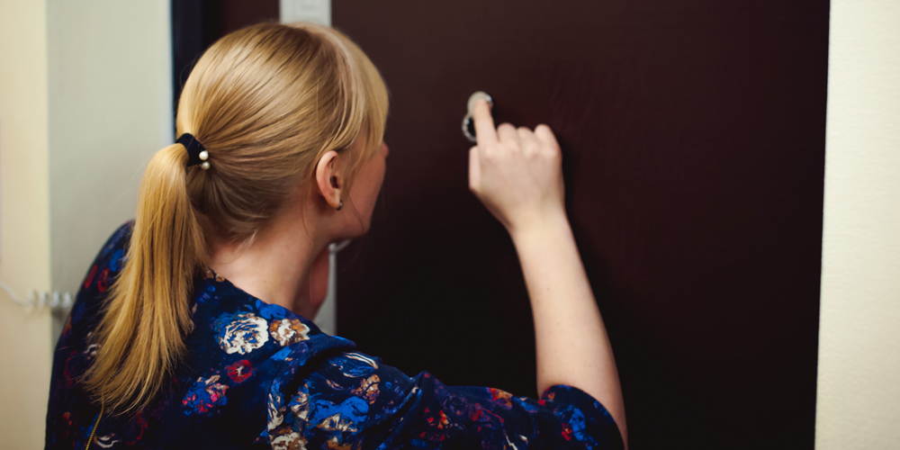 Woman Looking Through Peephole